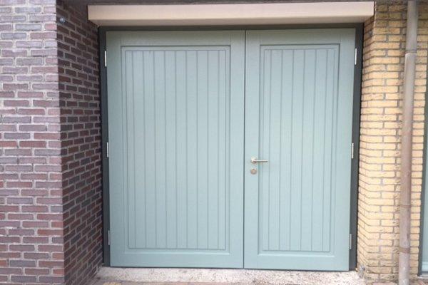 openslaande houten garagedeuren Lelystad type Badings